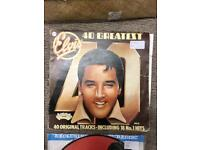 Elvis greatest hits LP. Sisters pitch
