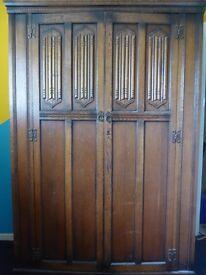 Antique 'Old Charm' Oak carved wardrobe by Wood Bros Furniture