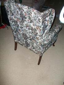 High backed tapestry pattern armchair.