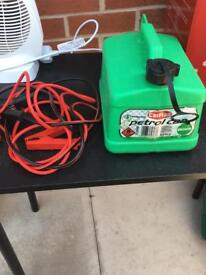 Petrol jerry can and jump leads