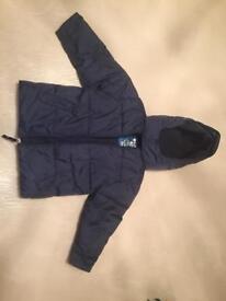 Padded blue jacket with full fleece lining. Age 4.