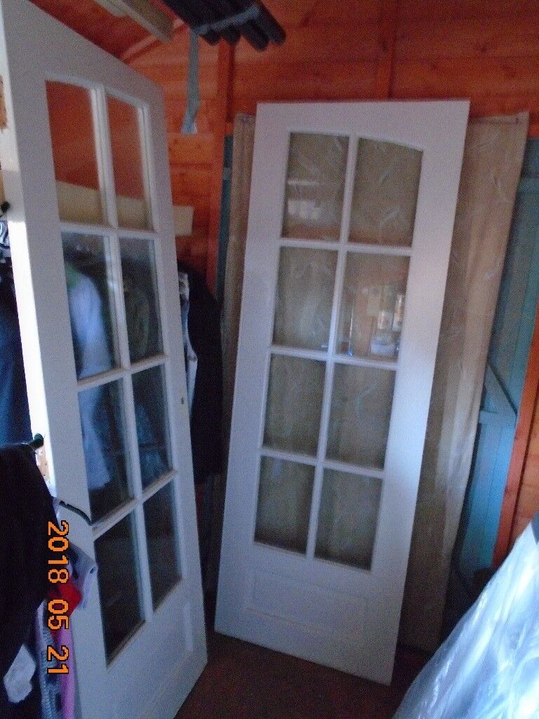 A Pair Hard Wood Of Painted Hardwood Double Interior Glass Panel