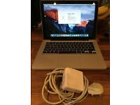 "MacBook Pro 2010 ""Core 2 Duo"" and charger"