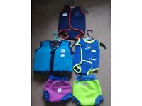 Bundle of baby swim happy nappies and wraps /wetsuits/float vest from 0-36 months