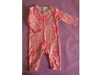 Pink romper suit