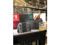 BRAND NEW SEALED NINTENDO SWITCH GREY WITH LEGO WORLDS GAME INCLUDES RECEIPT FOR WARRANTY