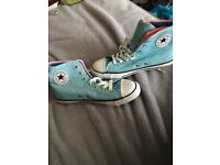 Light blue converse trainers never been worn!