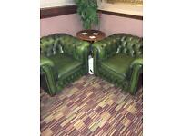 Pair of green leather Chesterfield armchairs