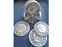 Aztec Calendar Coasters with lots of age - comes in a stand - bone material. Lovely items.