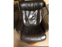 Dark leather recliner chair and footrest for sale