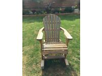 Gorgouse large wooden garden rocking chair.