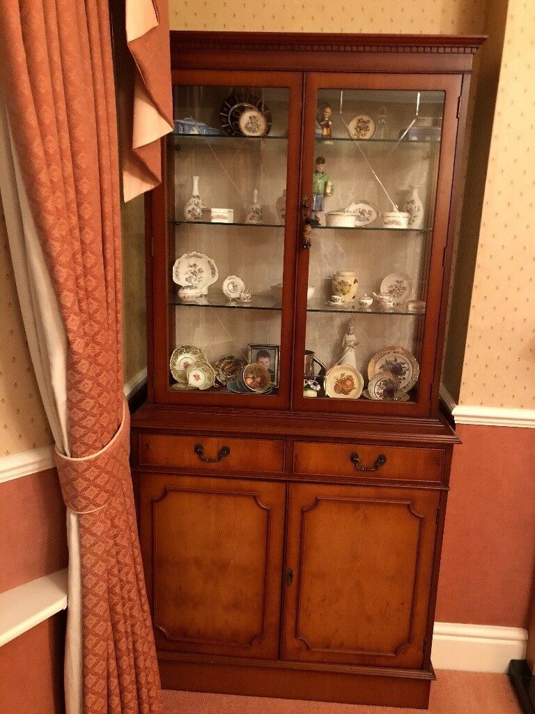 Yew display cabinet . Comes in two pieces . Light in glass display .very good condition.