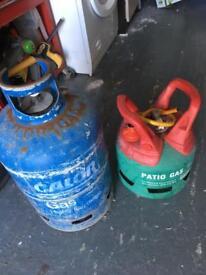 2 empty gas bottles