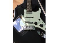 Fender American Standard Stratocaster in black with lime green scratch plate and upgraded pickips