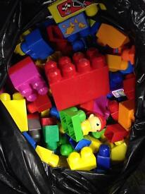 Black bag full of mega blocks