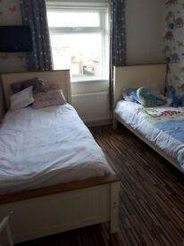 Two cream and oaks single beds