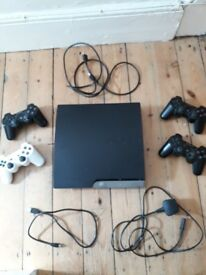 Playstation 3 (PS3) 160GB slim games console with four controllers and 18 games