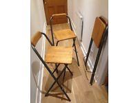 3 wooden bar stools.