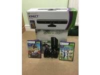 Xbox 360 slim with Kinect, two controllers and four games (in original boxes)