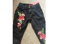 Size 8 ripped embroided jeans