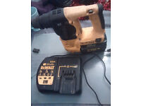 Dewault 24 volt sds drill with chisel action and charger with new brushes and charger