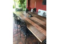 wooden dining room table with 6 wrought iron chairs