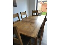 6 seat, solid oak dining table and 6 chairs for sale