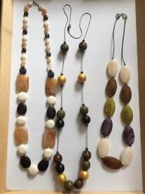 Set of three long dress necklaces