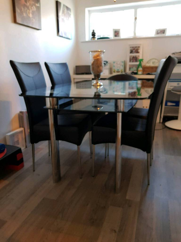 Dining Table and 4 chairsin Nottingham, Nottinghamshire - family dining table and 4 chairs. The chairs have no marks on and they are in a good condition. The glass table top is in a overall good condition But has very light scratches on one of the corners.Any questions please feel to ask away