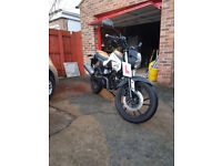 As new, very low miles, semi-auto 125cc