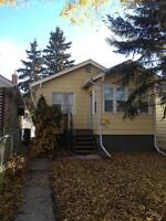Lovely 2 bd character home with fully  6f fenced yard and garage