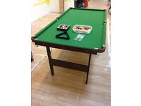 6ft pool/ snooker table with balls, triangles, cues and cue stand