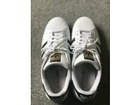 White original adidas shoes (unisex), size 10.5
