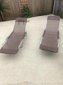 X2 Brown folding sun loungers