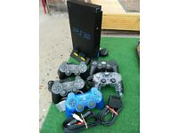 Playstation 2 + games + controlers + gun's + steering wheel.. £100 o.n.o.
