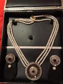 Real cultured Pearl necklace with earrings.