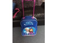 Girls suitcase and bag frozen