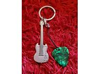 Metal Keyring. Various styles of guitar and drums available. Plectrums included