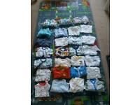 27 newborn/0-3 sleepsuits