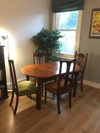 Extendable solid wood dining table with 4 upholstered antique chairs