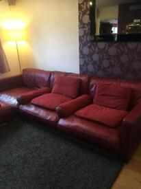 Large deep red leather sofa