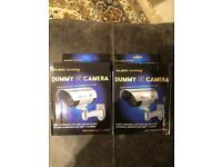 Two dummy security cameras