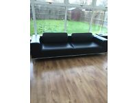 2x very large black leather sofas
