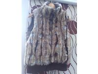 Fur waistcoat for women size 12 or 14 from Debenhams and designed by butterfly
