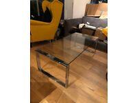 Glass-top coffee table