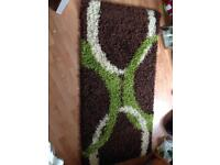 Brown and green rug.