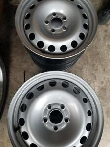 BRAND NEW TAKE OFF FACTORY OEM FORD FOCUS  /   FUSION 16 INCH STEEL WHEEL SET OF FOUR. NO SENSORS.