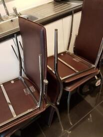 4 brown leather chairs
