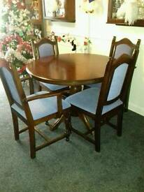 extendable solid oak dining room table and 8 chairs