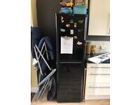 Black Indesit fridge freezer
